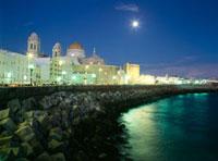 Seafront and cathedral of Santa Cruz at dusk