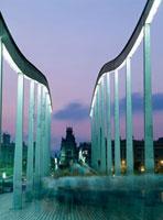 People walking across the swing bridge at dusk,Blurred Mot