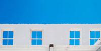 Windows against blue sky