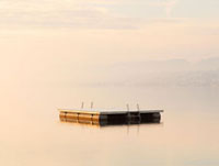 Snow dusted pontoon in Lake Zurich at dawn