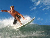 Blond surfer on crest of a wave,low angle view