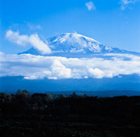 Mount Kilimanjaro with low clouds.