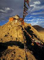 Leh Monastery and prayer flags at dusk