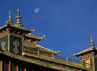 Moon over the golden rooftop of the Utse at  Samye Monastery