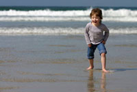 Child on Sennen Cove beach