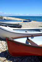 Boats on pebble beach
