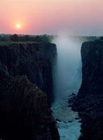 Looking along Victoria Falls at dusk from Zambia to Zimbabwe