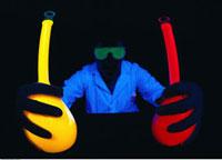 Lab Worker Holding Flourescent Beakers