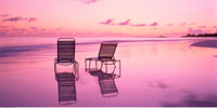 Two Chaise Lounges on the Beach At Sunset Eleuthera