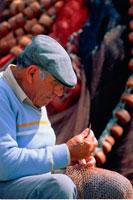 Mature Man Repairing Fishing Nets Algarve