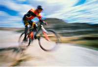 Blurred View of Man Mountain Biking Drumheller