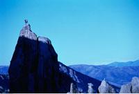 Rock Climbers on Summit of Mountain