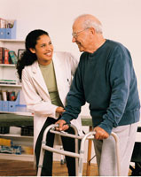 Female Physiotherapist Helping Mature Male Patient with Walk