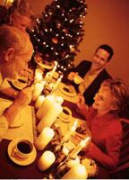 Family Eating Dessert at Christmas Dinner Table