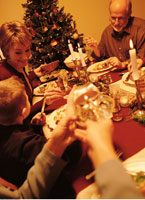 Family Gathered at Table for Christmas Dinner