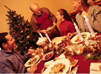 Grandfather Serving Christmas Dinner to Family