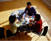 Overhead View of Business People At Desk in Meeting
