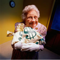 Portrait of Mature Woman Holding Bags of Money