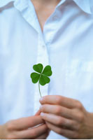Woman Holding Four Leaf Clover