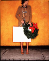 Woman Holding Shopping Bag and Wreath
