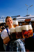 Portrait of Oktoberfest Girl Holding Mugs of Beer Munich