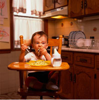 Baby Sitting in High Chair Eating