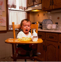 Portrait of Baby Sitting in High Chair