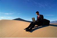 Businessman Using Laptop Computer In Desert Death Valley