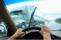 Driver's Perspective in Car on Road with Transport Truck in