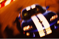 Blurred View of Racing Car on Track