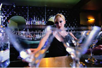 Portrait of Female Bartender at Bar with Close-Up of Martini