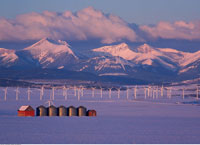 Wind Turbines and Mountains In Winter