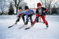 Kids Playing Ice Hockey Outdoors