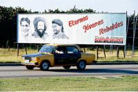 Communist Party Billboard and Taxi Havana
