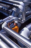 Worker Examining Pipe Installation