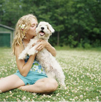 Girl with Dog in Meadow