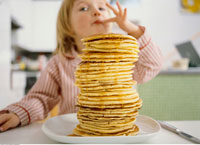 Huge Stack of Pancakes in Front of Girl