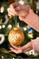 Girl Holding Christmas Ornament