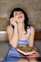 Woman Crying and Holding Box of Chocolates