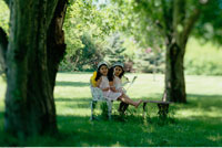 Sisters in Fairy Costumes in Park