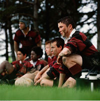 Rugby Team Sitting on Sidelines