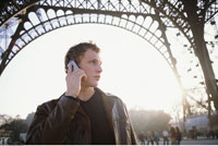 Man on Cell Phone in Front of Eiffel Tower