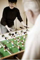 Couple Playing Table Soccer