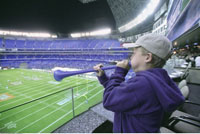 Boy At Sports Event Blowing Horn