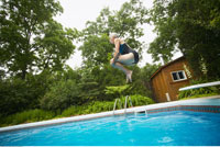 Woman Jumping into Swimming Pool