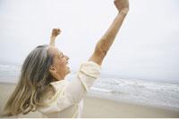 Woman Cheering at Beach