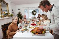 Man Carving Turkey for Christmas Dinner