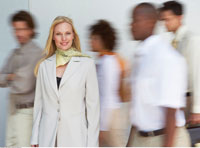Portrait of Businesswoman with Blurred Business People