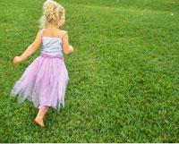 Girl Running on Grass