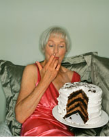 Woman Eating Cake in Bed